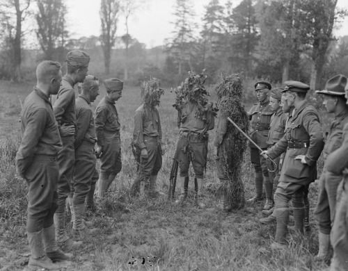 Men of the American 77th Division receiving instruction in camouflage from a British instructor at Moulle, 22 May 1918.