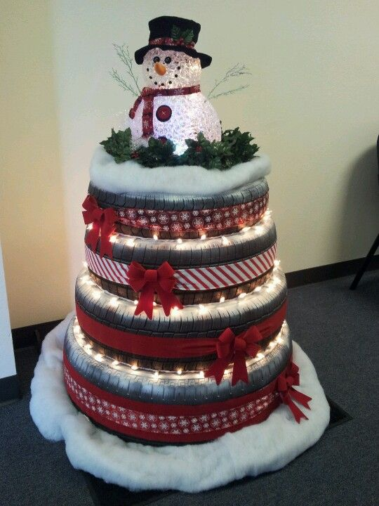 I created this Christmas 'tree' from old tires for the lobby of the automotive repair shop my hubby and I own. Love it!!!
