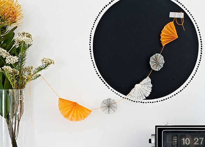 Fan hanger garland by Véronique from Pichouline Cut, fold and thread! what you'll need: *wire *needle *punch *paper or ricepaper Step 1: Cut out the paper as a rectangular. One size needs to be the half of the other size....