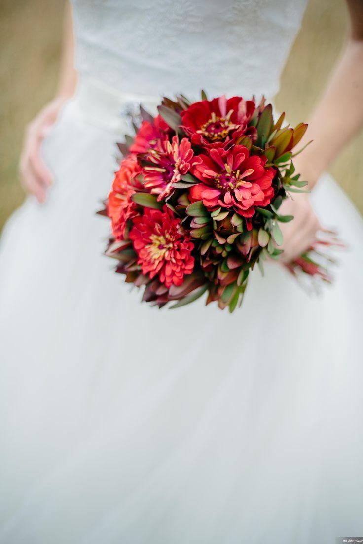 Fiery bridal bouquet featuring crimson zinnias and safari sunset.