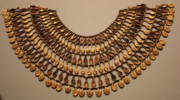 Broad collar of Nefer Egyptian gold necklace displayed in the Metropolitan Museum excavated from the Tomb of the 3 Foreign Wives of Thutmose III (c.1475-1425 BC).