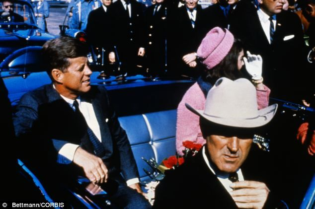 The real thing: President Kennedy smiles in the sun as he rides from the Dallas airport into the city with his wife and Texas Governor John Connally in a photo taken moments before he was shot 1963