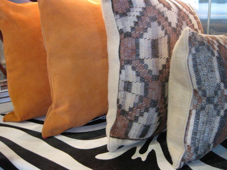 orange suede pillows