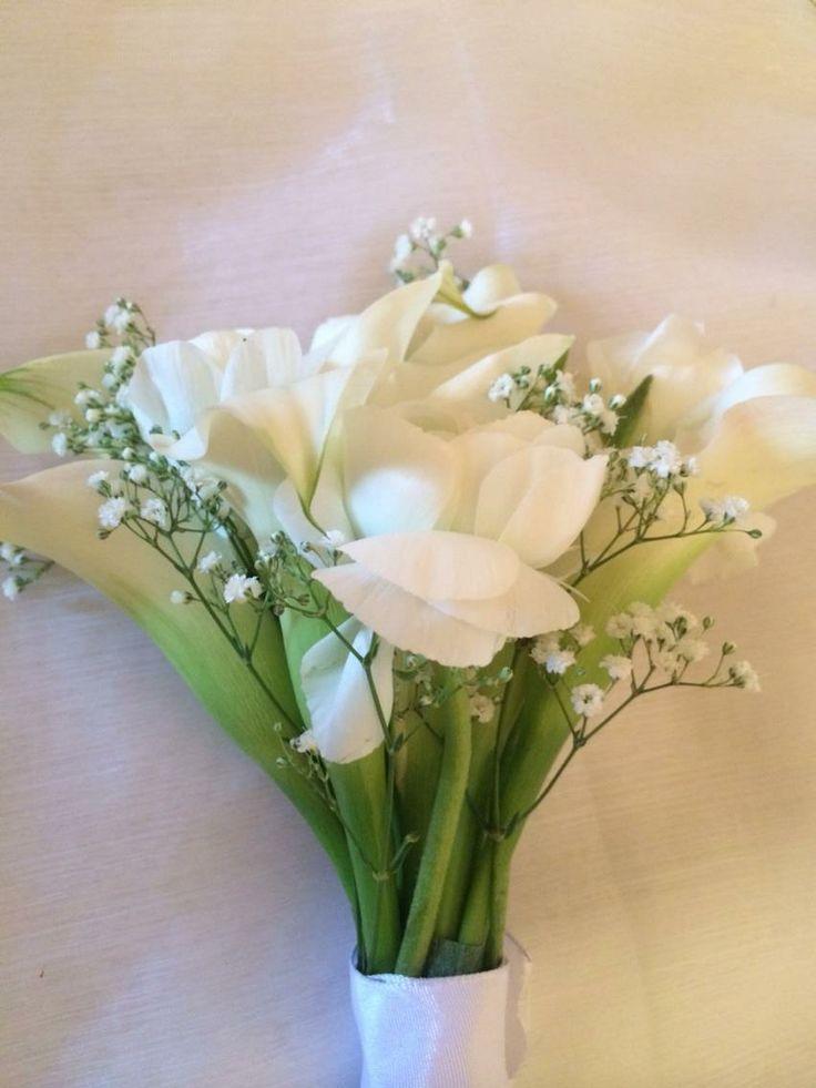 white Calla Lilly, Gyp, & ranuculus bouquet www.facebook.com/entirelybridal . www.entirelybridal.co.uk