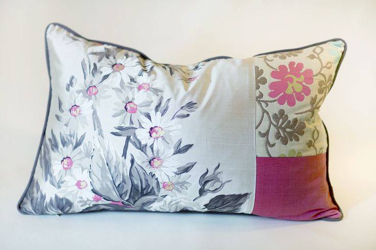 Handmade Pillow 	Size: 25 x 15 inch 	Up-cycled Fabric  Each piece has been thoughtfully designed and locally produced, by hand, primarily from resources diverted from the waste stream.   We hope you will LOVE your new accessories as much as we loved creating them for you!