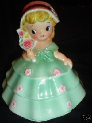 """PY/Ucagco Girl Cookie Jar in Green This is a beautiful small cookie jar by PY. It was distributed by Ucagco (United China and Glass Company) prior to 1961. She was issued in several different colors, this one being green. She is not seen very often, especially in such good condition. She is approximately 8"""" tall and strongly resembles the Dainty Miss line that was produced by PY for Lefton."""