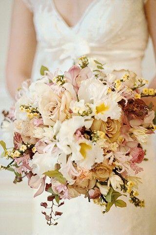 Wired bouquet of cattleya and cymbidium orchids, Quicksilver roses, ranunculus, euphoria, nerines, tuberose, autumn eucaluptus and ivy