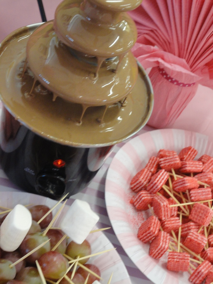 A chocolate fountain is a great treat for the children....keeping in mind the theme, put out some pink napkins, add some theme'd food on toothpicks...waffer, and also some fruit. Make sure the chocolate fountain is always supervised