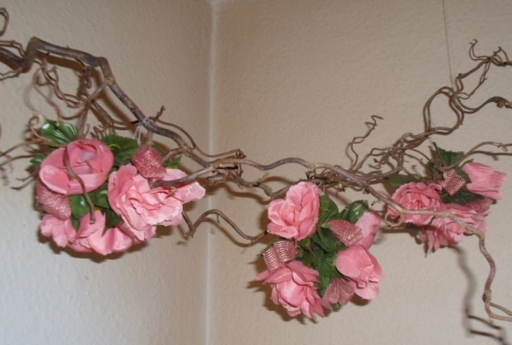 Harry Lauder's walking stick decorated with pink flowers.