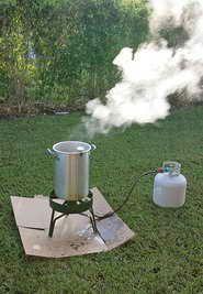 Set your turkey fryer up outside