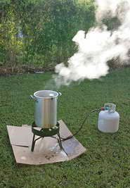 Set your turkey fryer up outside