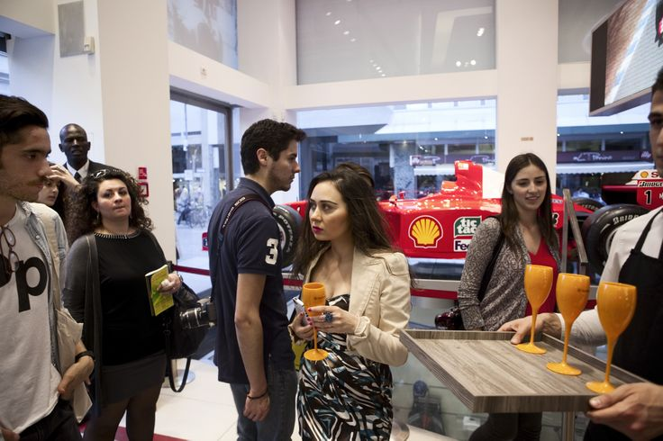 Ferrari Store boutique in Milan during the Salone del Mobile. #ferrari #ferraristore #milan #boutique #salonedelmobile #fuorisalone #cavallinorampante #prancinghorse #cocktail #party #shots #pics #red #people #enthusiasts