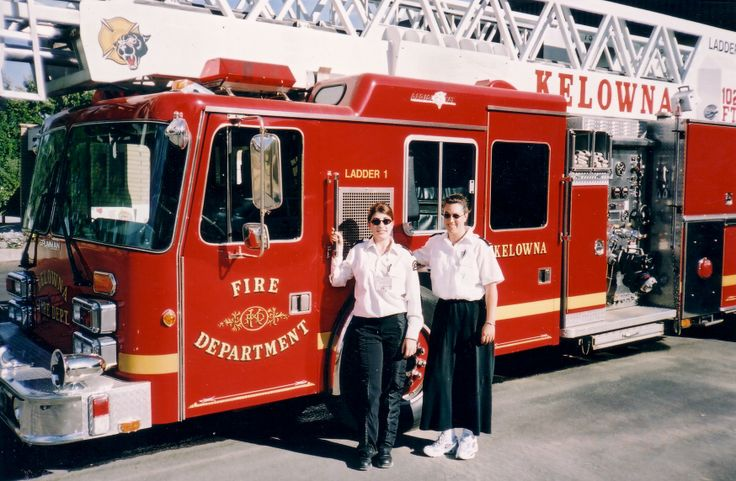 Here is a throwback photo of 2 female volunteers around the Kelowna Fire Department truck.