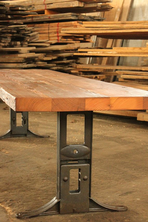 reclaimed wood industrial conference dining table with cast iron machine legs