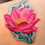 Pink lotus tattoo in water. Like the detail in the petals.