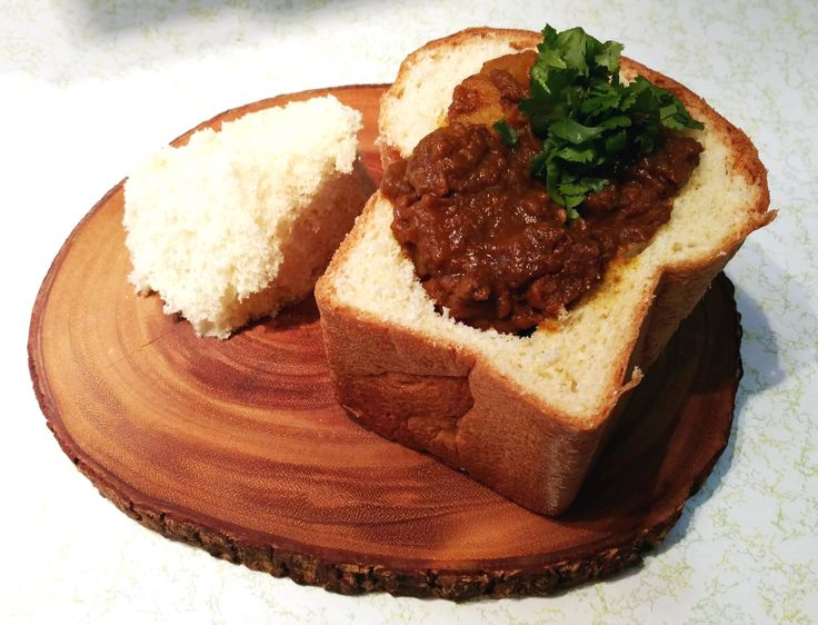 Bunny Chow (South African lamb curry in a half loaf) [OC] [3932x3006]