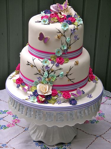 Bright summer blooms wedding cake; the nice icing website has amazing cakes & cupcakes.