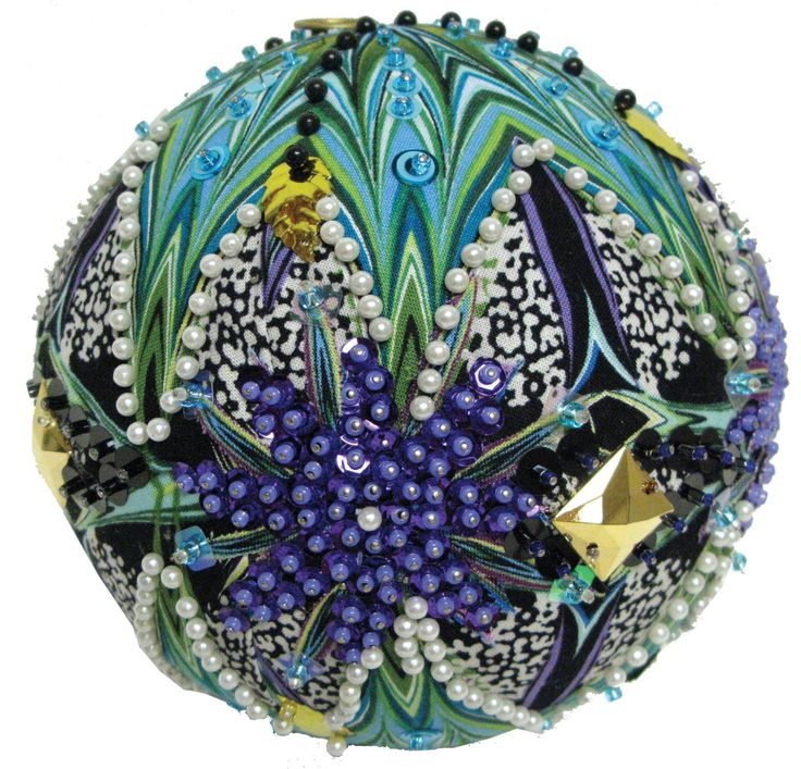 Combine Paula Nadelstern's kaleidoscope style fabric with:    sequins   seed beads   and a simple styrofoam ball   to make...          In...