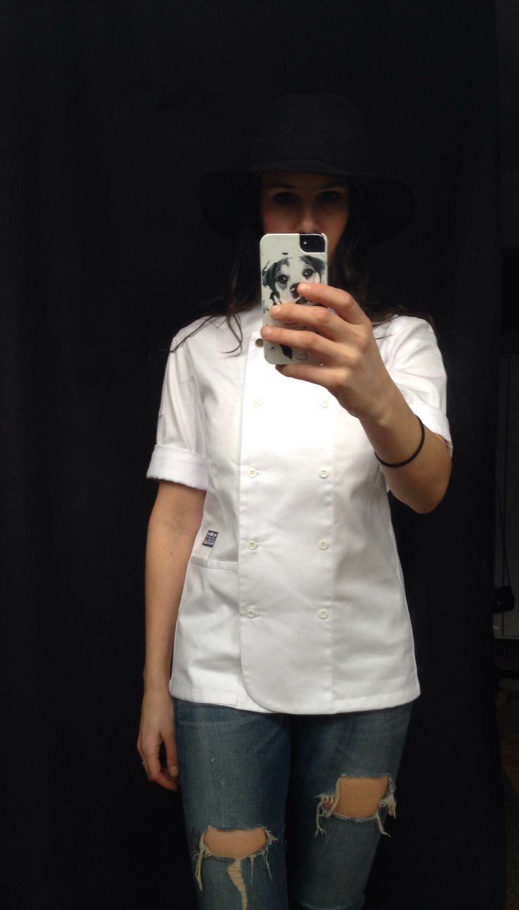 Tlit Chef Goods Women's Chef Coat. Cut for a woman with longer rear coverage, apron tab, pit vents, and adjustable waist cinch. Styled with Rag & Bone hat and jeans.