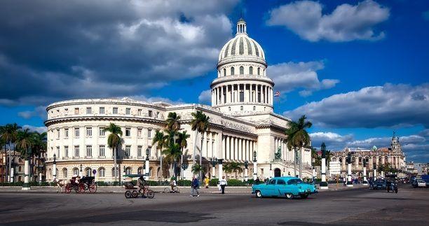 Cuban flag flying on top of the Capitolio Building. #Havana, #Cuba. #CubaBnB https://cubabnb.com