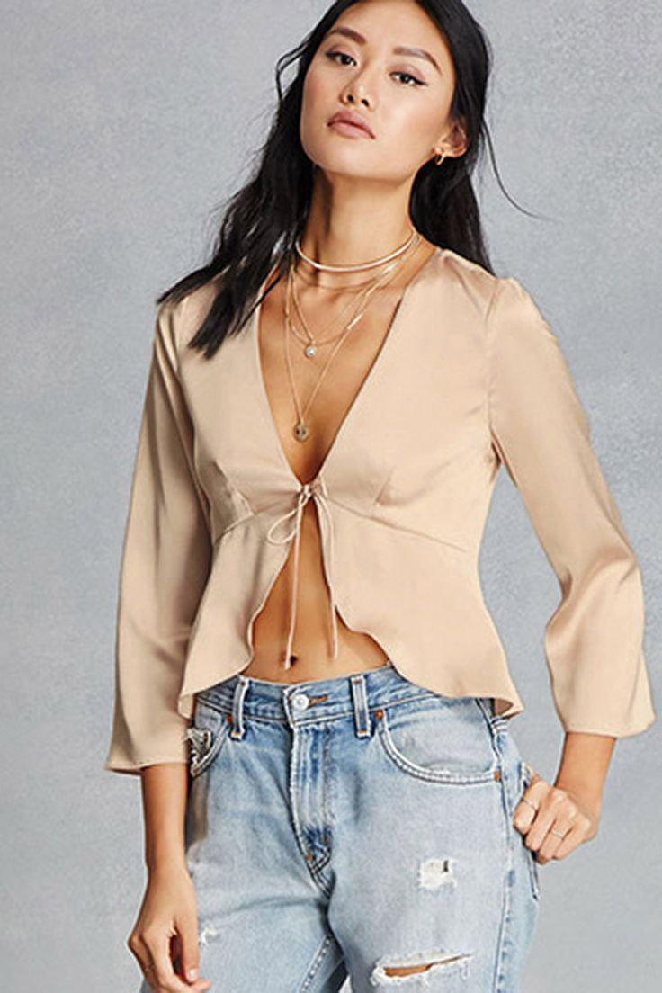 This satin top features a peplum hem, a V-neckline with self-tie laces, and 3/4 sleeves. This is an independent brand and not a Forever 21 branded item.