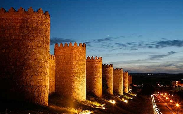 "AVILA, Spain: The defensive wall surrounding the original town was constructed in the 11th century. It features 82 semicircular towers and 9 gates, and is one of the most complete examples of town walls in Spain.  The writer José Martínez Ruiz described Avila as ""perhaps the most 16th century town in Spain"", as it has maintained an austere religiosity in the face of progress.  The town is known as Ávila of the Knights, the King and the Loyalists."