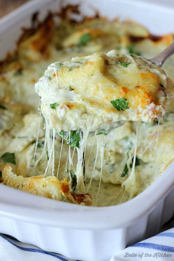 This Artichoke and Spinach Ravioli Bake is made with a creamy and delicious sauce, fresh spinach, mozzarella, and cheesy ravioli. An easy, delicious meal!