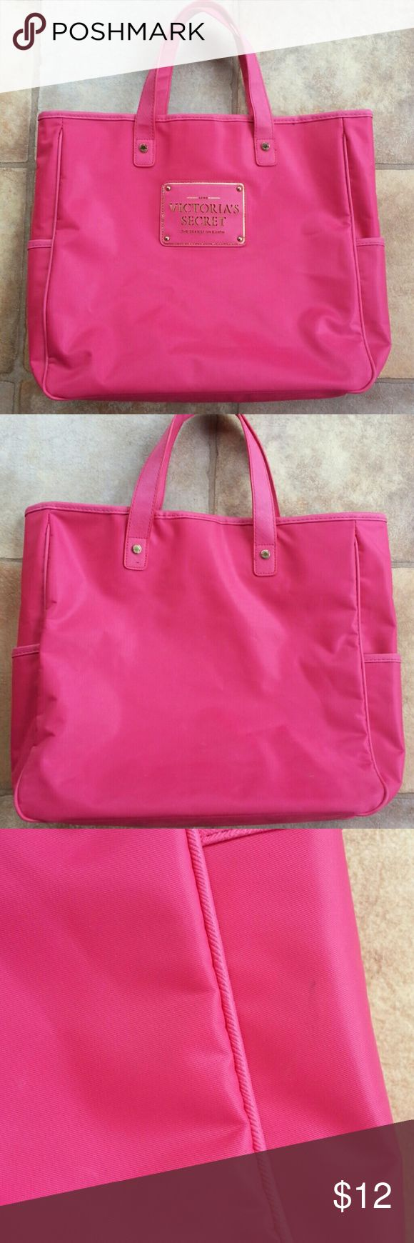 VS Hot Pink Tote Please refer to pictures.  There are many dents, dings and small stains.  Interior is in great condition. Bag got lodged between other things causing damage outside.  There are no rips or tears.  I cleaned the outside as best as I could. You may have better luck than me. Two side pockets and button closure Measures 12 1/2H X 13W X 3D Bundle and save 15% Thanks for looking! Victoria's Secret Bags Totes