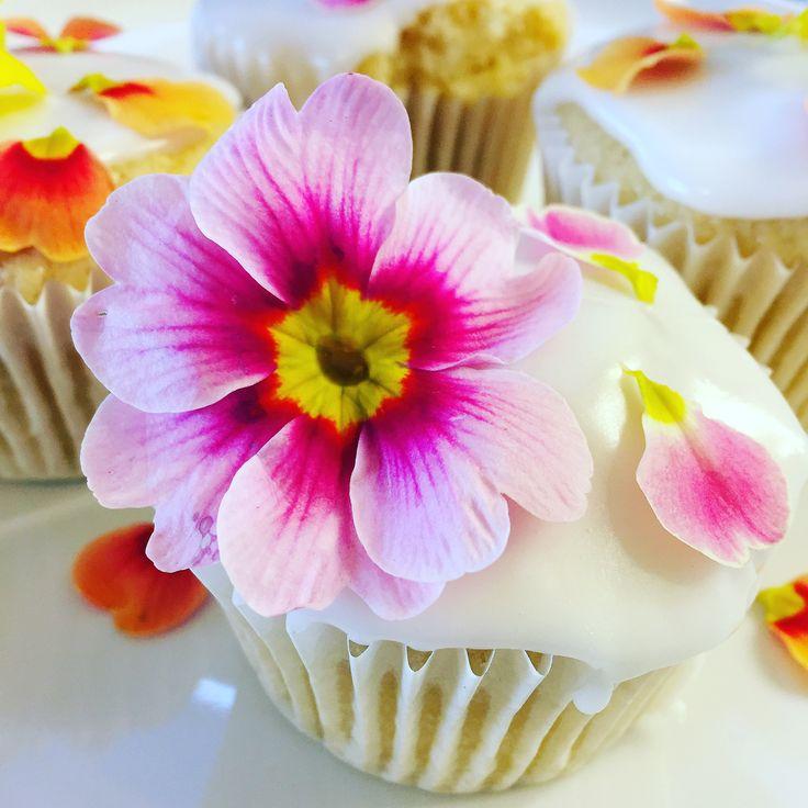 spring primrose edible flower topping a lemon curd filled cupcake