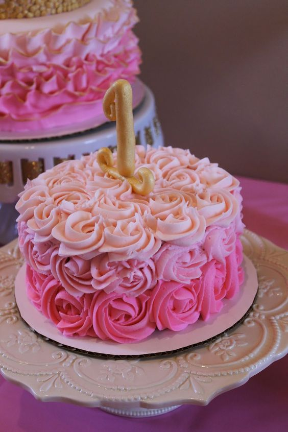 Gorgeous pink ombre rosette smash cake for a delightful 1st birthday party