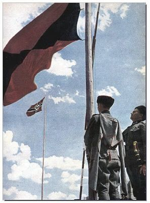 The Cossack flag flies alongside that of Nazi Germany