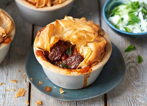 A spicy, delicious pie made with lamb neck fillet and filo pastry and served with a minty cucumber dip