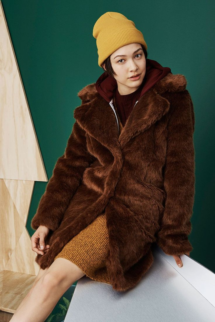 Faux RealNot only will this super-fuzzy outerwear option keep you toasty, it's also a great statement piece to toss over nearly any imaginable ensemble. We're especially fans of the athletic-leaning, dress-and-hoodie combination layered beneath, plus the mustard beanie on top.Primark Coat, $46; Jersey Zip-Up, $9; Knitted Dress In Wine, $23; Knitted Dress In Mustard, $23. #refinery29 http://www.refinery29.com/primark-fall-2015-collections#slide-1