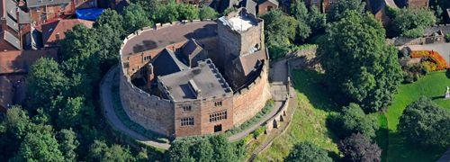 Tamworth Castle is sited in the town centre Pleasure Grounds, overlooking the confluence of the River Tame and Anker.