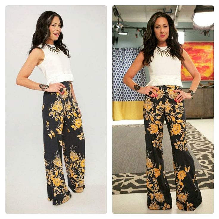 white cropped, sleeveless blouse + black and mustard floral high waist, wide leg pants