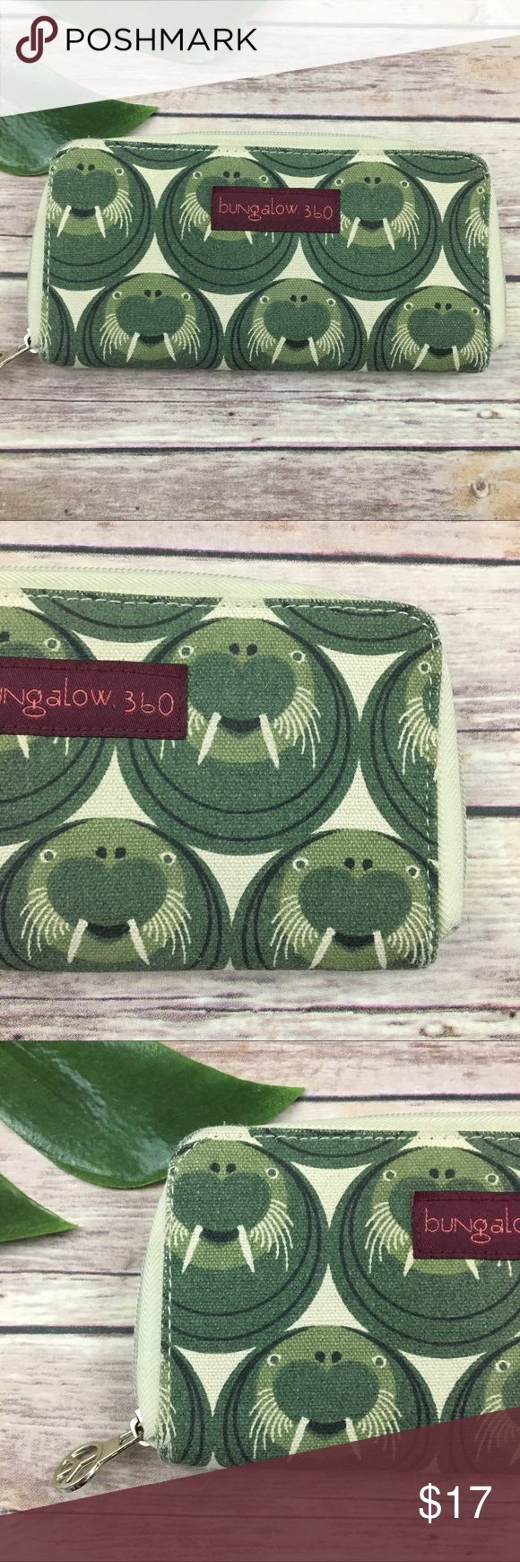 Bungalow 360 green walrus print wallet Bungalow 360 walrus zip around canvas wallet. It is free from any rips or stains but does have some wear, please see pictures. It measures about 7 inches long, about 4 inches tall and about 1 inch deep. bungalow 360 Bags Wallets