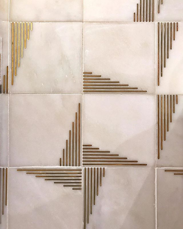 Incredible marble tile with brass inlay! We love that you can quarter-turn these tiles to create new patterns.  @annsacks @kbis_2017