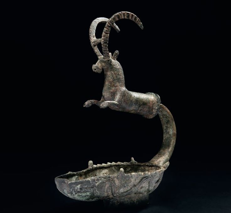 South Arabian bronze lamp, 5th - 4th century B.C. With caprine protome handle, 26.5 cm high. Private collection