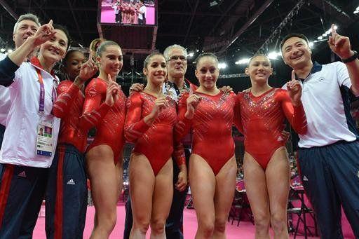 Nice work.  Olympics ~ July 31, 2012; Gabrielle Douglas, Mckayla Maroney, Alexandra Raisman, coach John Geddert, Jordyn Wieber and Kyla Ross celebrate winning gold. (AFP)