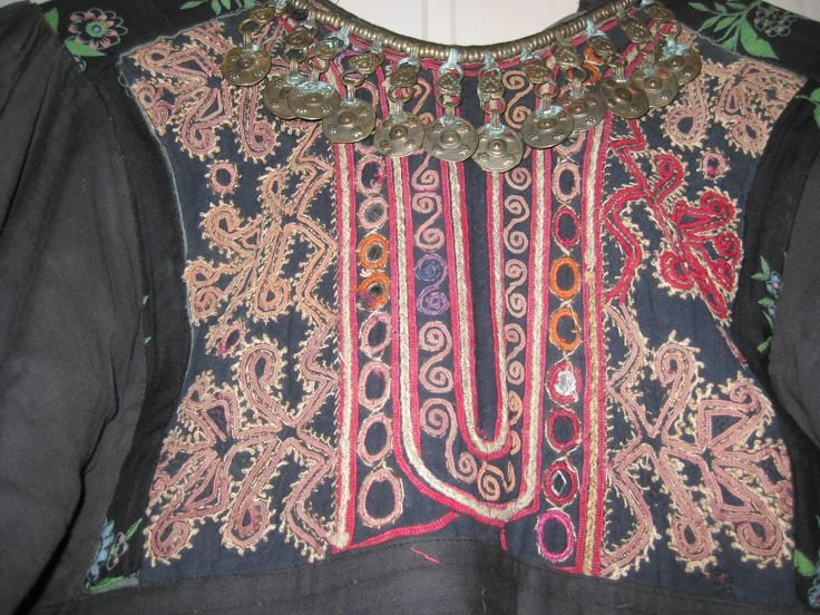 The Koochi dresses, brought back to the West, are those that identified Afghanistan in the 1970s hippie era. This dress is a mixture of old pashtun embroideries and black/ printed (russian) cotton. Made in Norway in the 70th