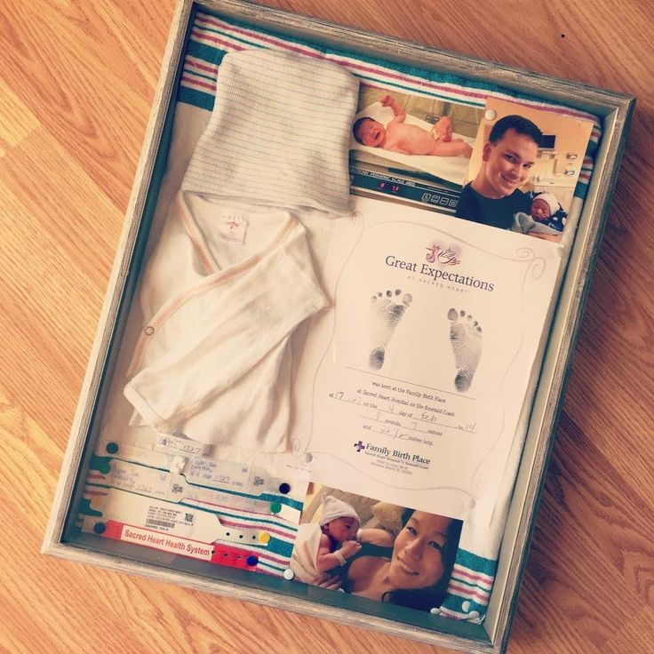 Shadow box - Whats inside Footprints, birth announcement if you have one, first photo if not, Hospital provided baby shirt and hat, ID Tags and crib tag, baby's first or Last sonogram!