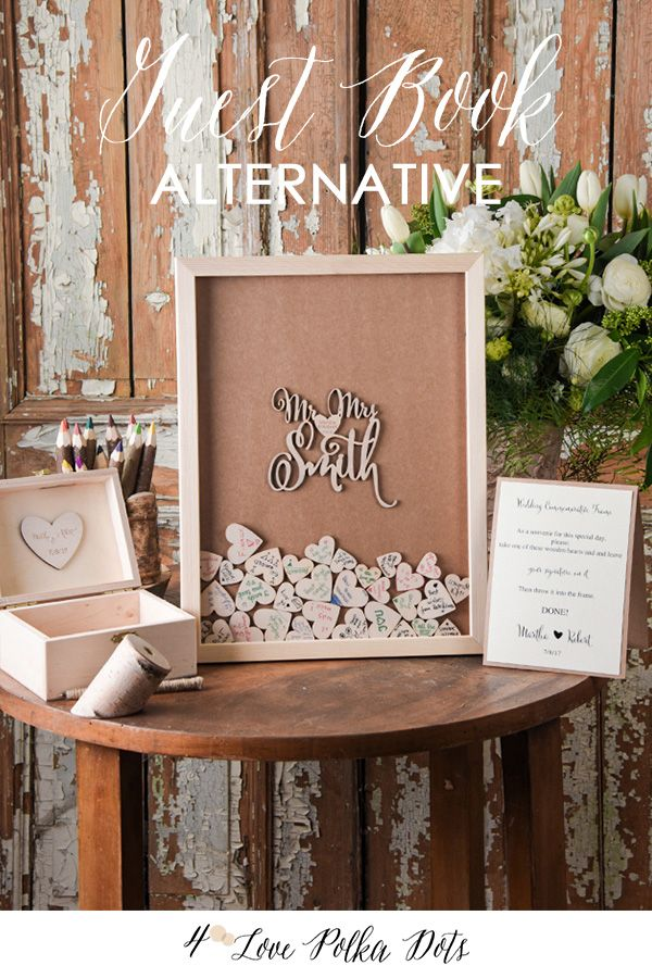 Have each guest sign a heart-shaped slice of birch bark and deposit it into a wooden memory box. Personalize the box with your names, wedding date and a custom message. Find more unconventional guest book ideas at 4 Love Polka Dots and create a wedding day memory you can display all year long.