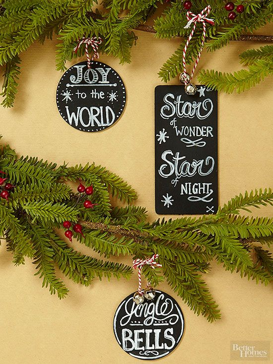 Your tree, your message. Pick a favorite carol lyric or holiday saying and write it on a chalkboard tag. To make, spray unfished wooden shapes with chalkboard paint, then use a pencil to lightly plan your design. Finish with a chalk pen, jingling bells, and red-and-white hanging loops.