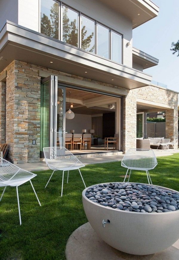 Lawn furniture and interesting water feature.