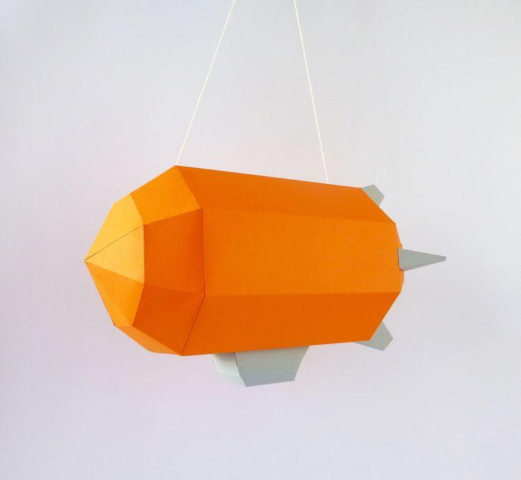 Orange+AIRSHIP+Rezervujte+si+už+nyní,+vyhlídkový+let+první+třídou+voranžové+vzducholodi.++Budete+potřebovat:+nůžky,+lepidlo,+pravítko,+trochu+času+a+trpělivost+Obtížnost:+střední+Velikost+:+30x16x16cm+Obsah:+16+dílů+-+instrukce+-+provázek+Pro+naše+3Dmodely+používáme+kvalitnístálobarevné+papíry+s+vysokou+gramáží.
