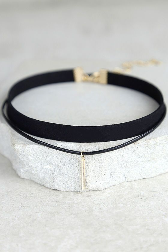 "The Sweetness Black and Gold Layered Choker Necklace is just like you, effortlessly chic! A black cord, accented with a shiny gold charm, joins a skinny black band to create this simple choker necklace. Shortest necklace measures 11"" around with a 2.5"" extender chain."