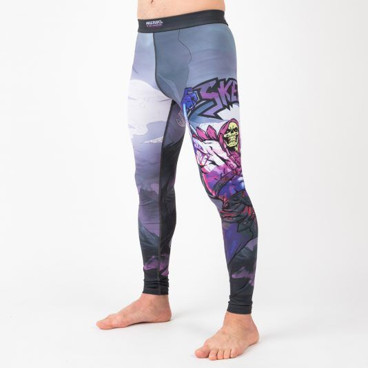 """These officially licensed Masters of the Universe Skeletor grappling spats feature a shot of Skeletor doing his """"world domination thing"""" on the left leg, and an image of Snake Mountain (as featured in season 3 of Cribs) on the right.  #spats #skeletor #tights #leggings #compressionpants #mastersoftheuniverse #1980s #bjj #fitness"""