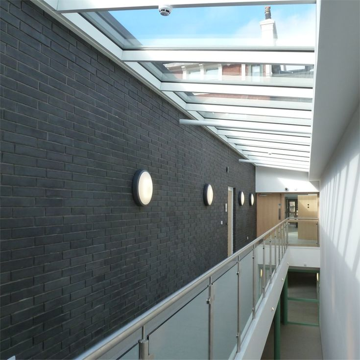 Belvidere Family Centre, John McCall Architects. Bright internal circulation with feature brick wall