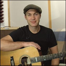 This is Justin Sandercoe.  His site, Justinguitar.com is an amazing gift from an outstanding teacher.   Over 500 free lessons that are thorough, clearly presented and complete.   You can without question learn to play the guitar with Justin's lessons for free.   Forum support is also exceptional.