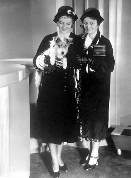 Bette Davis, with mother, Ruth, and dog in tow, arrives in Hollywood. December, 1930